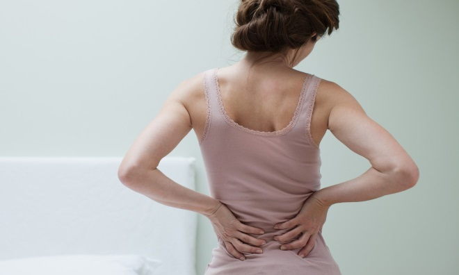 Почему болит спина при месячных