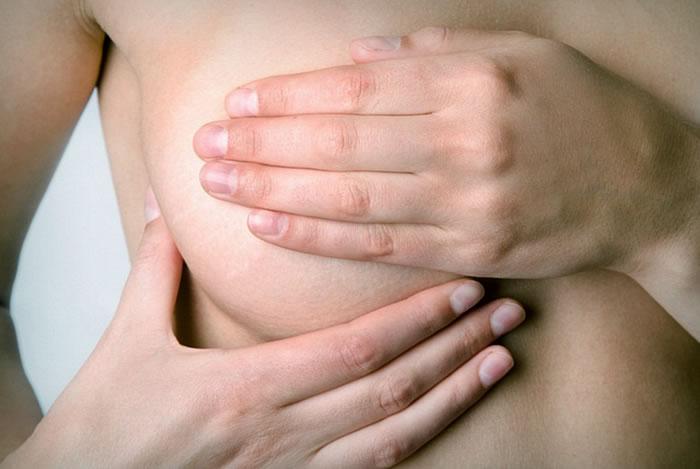 Почему болят грудные железы перед месячными