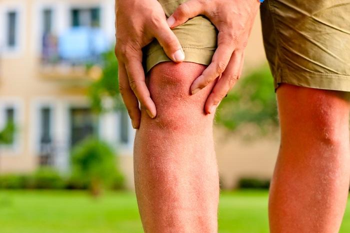 Почему болят колени и как лечить